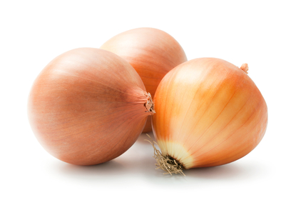 Arrangement of three ripe fresh onions isolated on white background